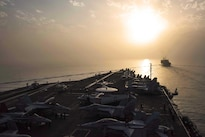 The aircraft carrier USS Dwight D. Eisenhower approaches the fast combat support ship USNS Arctic to conduct an underway replenishment in the Persian Gulf, Aug. 19, 2016. Navy photo by Petty Officer 2nd Class J. E. Veal