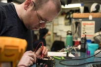 Navy Petty Officer 2nd Class Christopher Haney troubleshoots a hydra station power supply aboard the aircraft carrier USS Dwight D. Eisenhower in the Persian Gulf, Aug. 19, 2016. Haney is an electronics technician. Navy photo by Seaman Apprentice Joshua Murray