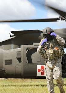 FORT MCCOY, Wis -- An Army Reserve Soldier from F Company, 1st Battalion, 214th Aviation Regiment out of Jonestown, Pa., exits a UH-60 Blackhawk helicopter during Exercise Global Medic at Fort McCoy, Wis., on Aug. 21, 2016. Global Medic is an inter-service training event that develops and evaluates the collective skills of Army Reserve Soldiers and other service members in a collaborative environment. (U.S. Army Reserve photo by Spc. Christopher A. Hernandez, 345th Public Affairs Detachment)
