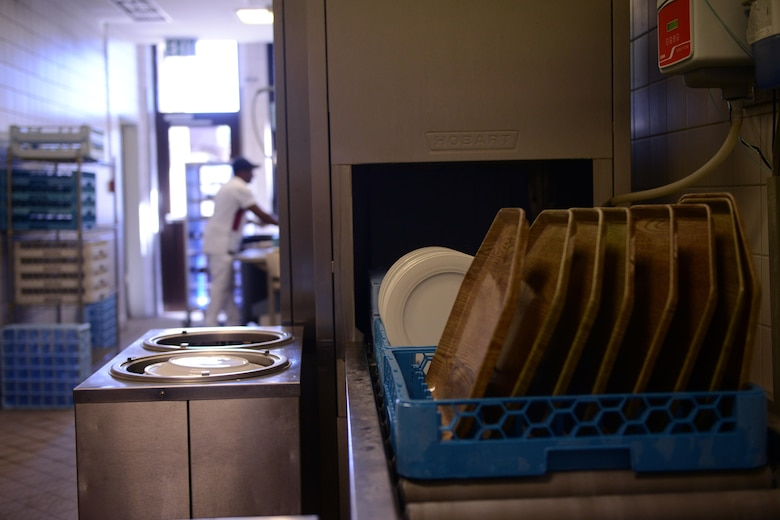 Newly washed dishes roll out of a dish washer at the Rheinland Inn dining facility Aug. 23, 2016, Ramstein Air Base, Germany. Airmen and civilian employees who work at the DFAC are required to keep the facility and its resources as clean as possible. (U.S. Air Force photo/ Airman 1st Class Joshua Magbanua)