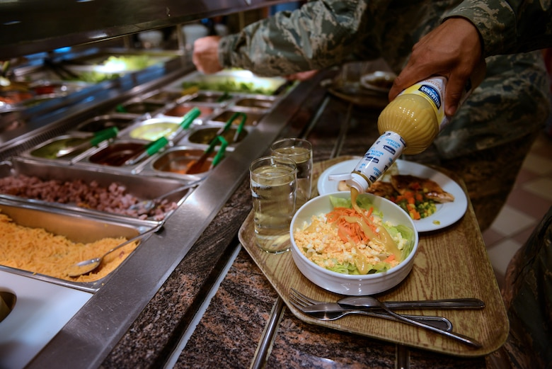Customers help themselves to the salad bar at the Rheinland Inn dining facility Aug. 23, 2016, Ramstein Air Base, Germany. Besides the salad bar, features of the DFAC include a hot-entrée line, a deli, snack bar and a grill. (U.S. Air Force photo/ Airman 1st Class Joshua Magbanua)