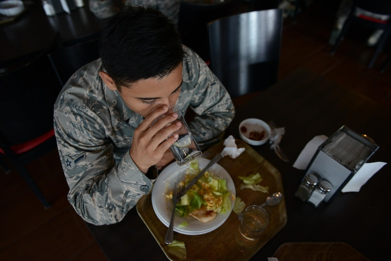 Airman Alfredo Piedrahita, 86th Munitions Squadron tactical air rapid response packages crew member, eats lunch at the Rheinland Inn Dining Facility Aug. 29, 2016, Ramstein Air Base, Germany. Dormitory residents' meals at the DFAC are paid for in advance. (U.S. Air Force photo/ Airman 1st Class Joshua Magbanua)