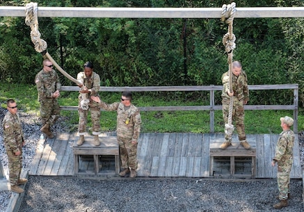 FORT JACKSON, S.C. – Reserve drill sergeants of the 1st Battalion 518th Regiment, 2nd Brigade, 98th Training Division coach basic combat training Soldiers on how to complete the rope jump obstacle at the Victory Tower complex on Aug. 23, 2016.  The reserve drill sergeants are on Fort Jackson in support of the Foxtrot Company mission which uses reserve and active duty drill sergeants to train new privates. (U.S. Army Reserve photo by Sgt. Michael Adetula, 206th Broadcast Operations Detachment)