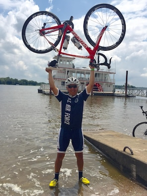Chief Master Sgt. Julio Flores, 544th Intelligence, Surveillance and Reconnaissance Group superintendent, Peterson Air Force Base, Colo., poses with his bicycle in front of the Mississippi River, Muscatine, Iowa, July 28. Flores joined 140 other Airmen in completing the 2016 [Des Moines] Register's Annual Great Bike Ride Across Iowa, simply known as RAGBRAI.  At the end of the seven day event, riders customarily dip their front tires in the river, signifying the end of the event. (courtesy photo)