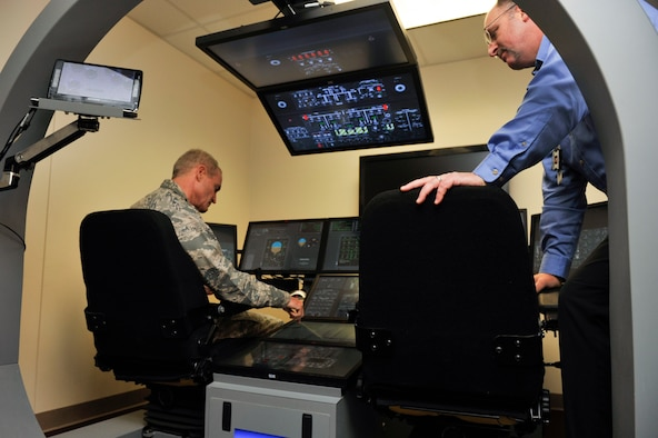 Lt. Gen. Darryl Roberson, commander of Air Education and Training Command, looks at a flight simulator at the C-130J Maintenance Aircrew Training System, Aug. 22, 2016, at Little Rock Air Force Base, Ark. Roberson toured the installation to observe the 314th Airlift Wing's role in how the total force concept is employed at Little Rock AFB. (U.S. Air Force photo by Staff Sgt. Regina Edwards)