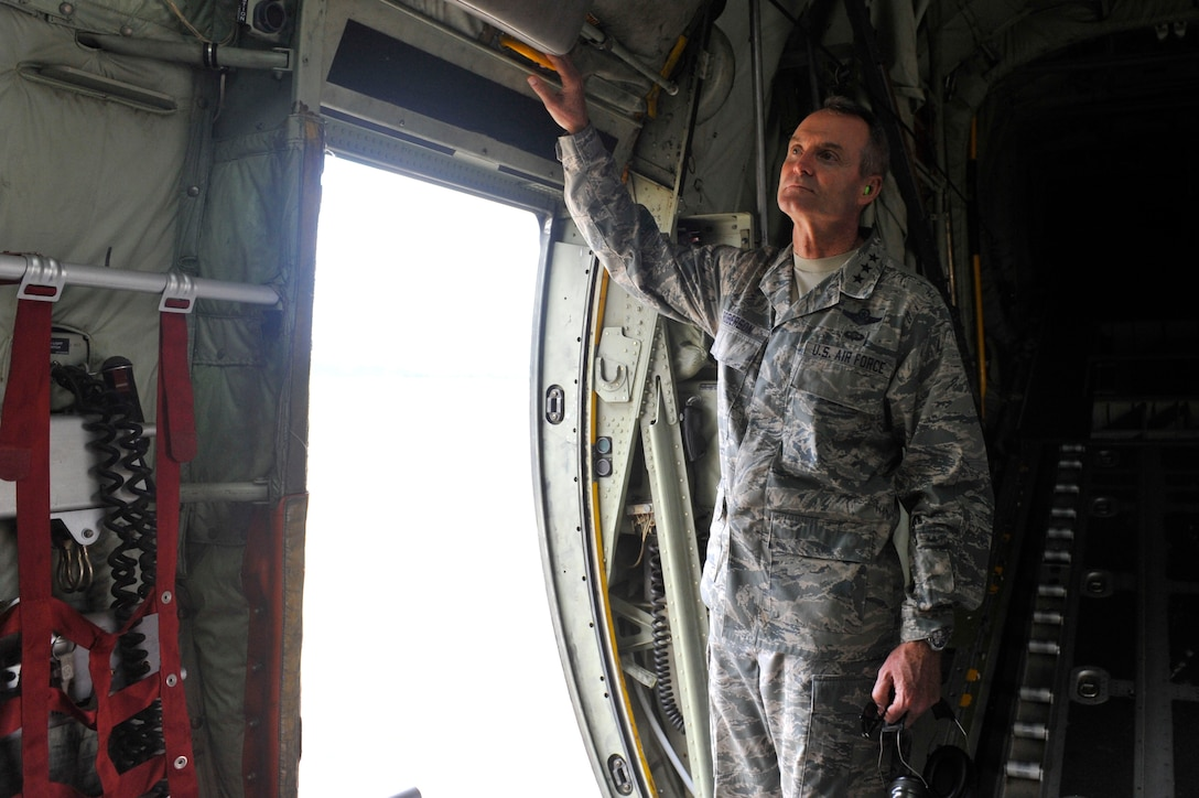 Lt. Gen. Darryl Roberson, commander of Air Education and Training Command, tours the inside of a C-130J Super Hercules Aug. 22, 2016, at Little Rock Air Force Base, Ark. During his tour, Roberson spoke to crew chiefs who recently received a Black Letter Initial which is earned when there are zero discrepancies during a flight. (U.S. Air Force photo by Staff Sgt. Regina Edwards)