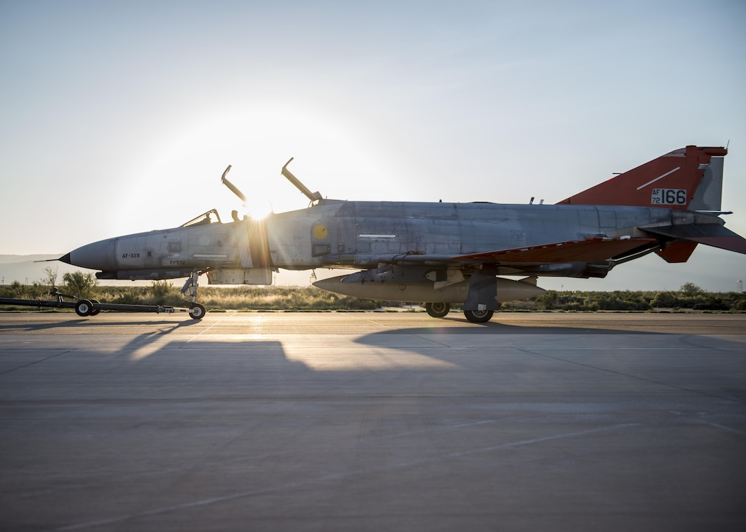 A QF-4 Phantom sits on the flight line before its final unmanned mission at Holloman Air Force Base, N.M. on Aug. 17. During its final mission, the QF-4 served its primary function as an aerial target and was shot at by an F-35 Lightning II from Edwards Air Force Base, Calif. (U.S. Air Force photo by Airman 1st Class Randahl J. Jenson)