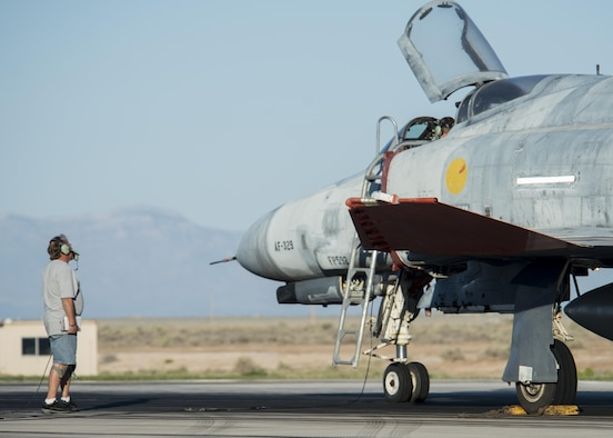 QF-4 Phantom maintainers go through pre-flight inspections before the aircraft's final unmanned mission at Holloman Air Force Base, N.M. on Aug. 17. The QF-4 mission will continue flying manned missions until the official end of the QF-4 program in December 2016. (U.S. Air Force photo by Airman 1st Class Randahl J. Jenson)