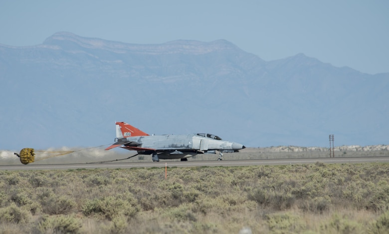 A QF-4 Phantom returns to Holloman Air Force Base after supporting an F-35 Lightning II mission in the skies above White Sands Missile Range, N.M. on Aug. 17. During the mission, an unmanned QF-4 served its primary function as an aerial target, while a manned QF-4 trailed to ensure mission success. (U.S. Air Force photo by Airman 1st Class Randahl J. Jenson)
