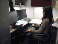 Karen Macatangay, industrial hygienist for the U.S. Army Corps of Engineers Sacramento District, demonstrates the correct seating position at a properly-fitted ergonomic work station.