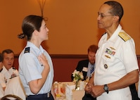 "U.S. Navy Adm. Cecil D Haney, U.S. Strategic Command (USSTRATCOM) commander, speaks with 2nd Lt. Shannon Miller, an intelligence officer with the 157th Air Operations Group, Missouri Air National Guard at the ""Next Generation Breakfast"" during the seventh annual USSTRATCOM Deterrence Symposium, La Vista, Neb., July 28, 2016. The breakfast served as an opportunity for senior leaders to mentor junior personnel within the nuclear enterprise. (DoD photo by Steve Cunningham/Released)"