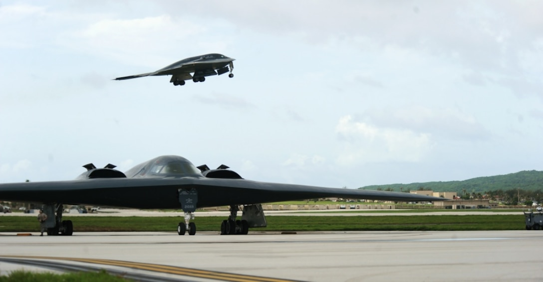 A B-2 Spirit deployed from Whiteman Air Force Base, Mo., takes off from the runway behind another B-2 Aug. 24, 2016 at Andersen Air Force Base, Guam. The U.S. routinely and visibly demonstrates our commitment to our allies and partners through the global operations of our military forces. (U.S. Air Force photo by Senior Airman Jovan Banks)