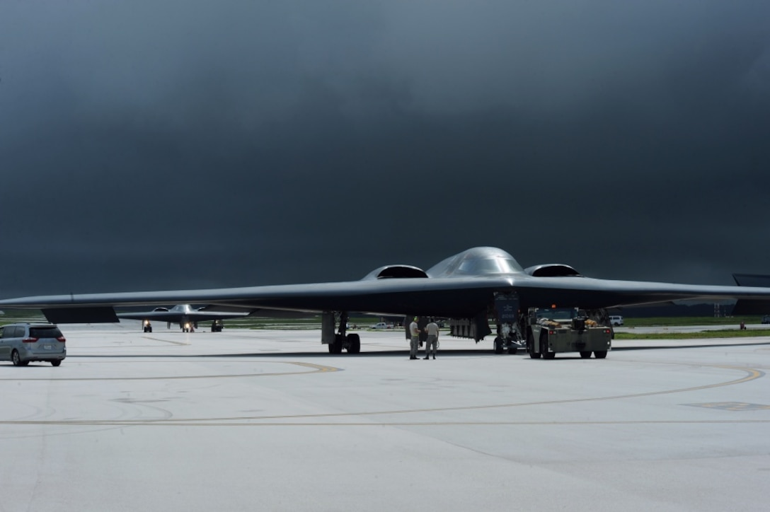 """As storm clouds gather in the background multiple B-2 Spirit aircraft land for aircraft recovery Aug. 24, 2016 at Andersen Air Force Base, Guam. The B-2s low-observable, or """"stealth,"""" characteristics give it the ability to penetrate an enemy's most sophisticated defenses and threaten its most-valued, heavily defended targets while avoiding adversary detection, tracking and engagement. (U.S. Air Force photo by Senior Airman Jovan Banks)"""