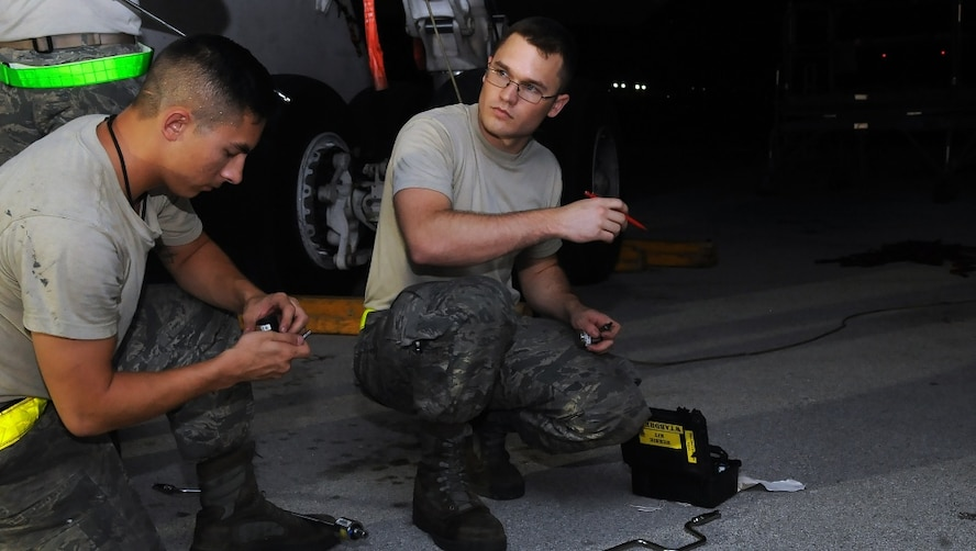 U.S. Air Force Senior Airman Evan Miesner, right, an electrical and environmental journeyman and Senior Airman Tyler Pham Vo, an aerospace propulsion journeyman, both assigned to the 509th Aircraft Maintenance Squadron, gather tools to perform maintenance on a B-2 Spirit aircraft Aug. 24, 2016. Bomber operations provide a unique and complementary capability to the Intercontinental Ballistic Missile and Ballistic Missile Submarine legs of the triad that underpins strategic deterrence. (U.S. Air Force photo by Senior Airman Jovan Banks)
