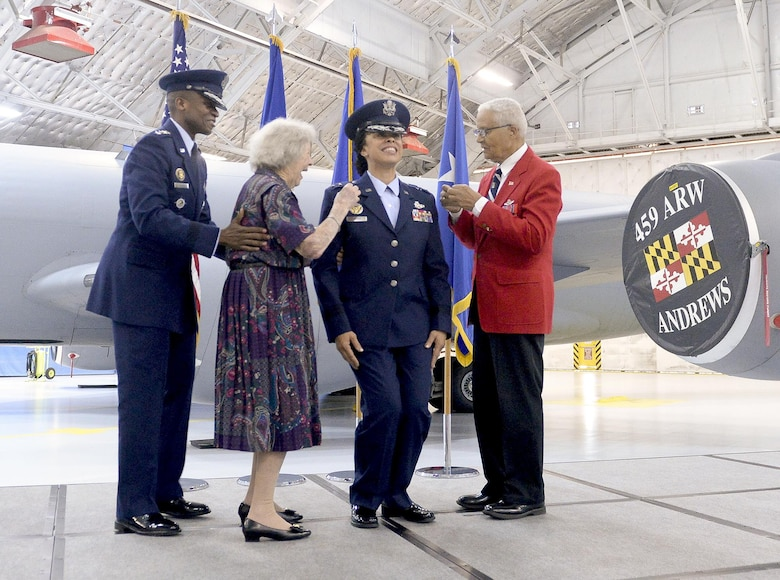 Gen. Darren W. McDew, the U.S. Transportation Command commander, watches as former Women Airforce Service Pilot Pauline Cutler-White and retired Col. Charles McGee, one of the original Tuskegee Airmen, pin new rank on Lt. Gen. Stayce D. Harris during her promotion ceremony Aug. 26, 2016, at Joint Base Andrews, Md. Harris became the Air Force's first black female lieutenant general, and also the first reservist to fill the position of the assistant vice chief of staff and director of the air staff. (U.S. Air Force photo/Andy Morataya)