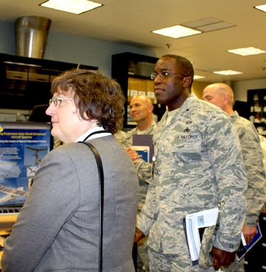 WRIGHT-PATTERSON AIR FORCE BASE, Ohio – Brig. Gen. Stacey T. Hawkins, Director, Logistcs, Engineering and Force Protection, Air Mobility Command (right) and Dr. Donna C. Senft, Chief Scientist, Air Mobility Command, along with core members of the AMC aircraft maintenance team visited the Materials and Manufacturing Directorate, Air Force Research Laboratory, to gain in-depth knowledge of additive manufacturing capabilities and technologies, Aug. 26. The visit included a directorate overview, discussions on additive manufacturing applications and visits to multiple research laboratories, highlighting 3-D printing capabilities for metals, polymer-based materials and functional material applications. AMC is exploring the possibilities of using additive manufacturing for replacement parts for aircraft during the life-cycle maintenance process. (Air Force photo by Marisa Novobilski/released)