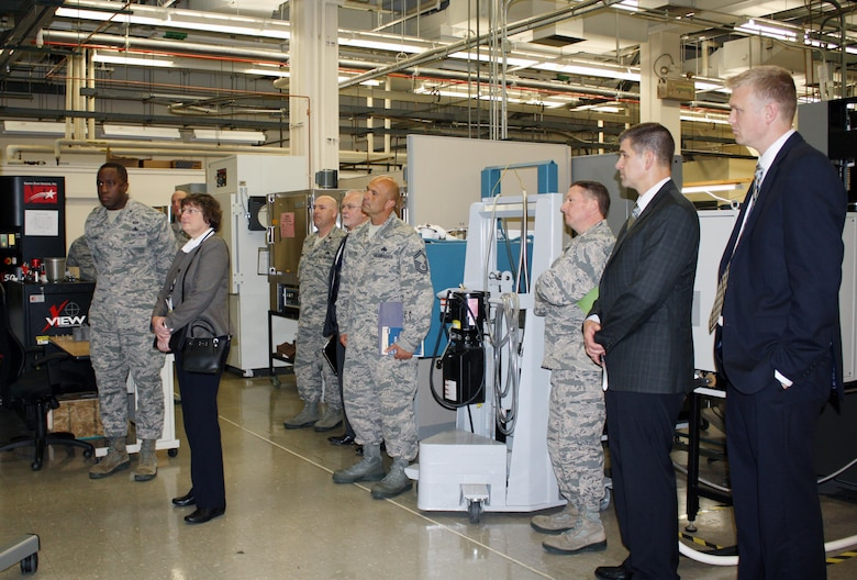 WRIGHT-PATTERSON AIR FORCE BASE, Ohio – Brig. Gen. Stacey T. Hawkins, Director, Logistcs, Engineering and Force Protection, Air Mobility Command (left) and Dr. Donna C. Senft, Chief Scientist, Air Mobility Command, along with core members of the aircraft maintenance team visited the Materials and Manufacturing Directorate, Air Force Research Laboratory, to gain in-depth knowledge of additive manufacturing capabilities and technologies, Aug. 26. The visit included a directorate overview, discussions on additive manufacturing applications and visits to multiple research laboratories, highlighting 3-D printing capabilities for metals, polymer-based materials and functional material applications. AMC is exploring the possibilities of using additive manufacturing as a cost-saving option for replacement parts for aircraft during the life-cycle maintenance process. (Air Force photo by Marisa Novobilski/released)