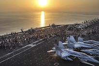 Sailors on the USS Dwight D. Eisenhower participate in the Out of the Darkness Community Walk on the flight deck to increase awareness for suicide prevention while at sea in the Arabian Gulf, Aug. 26, 2016. The Eisenhower is supporting Operation Inherent Resolve, maritime security operations and theater security cooperation efforts in the U.S. 5th Fleet area of operations. Navy photo by Petty Officer 3rd Class Casey J. Hopkins