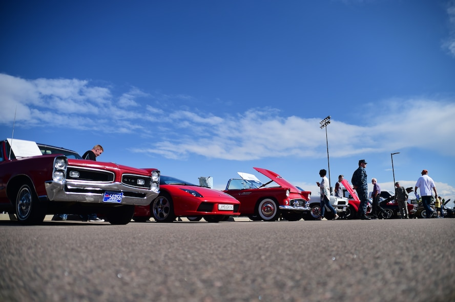 The Colorado Classic Car Council and the Cruisin' Panthers Automotive Club displayed a variety of vehicles at FunFest Aug. 26, 2016, on Buckley Air Force Base, Colo. FunFest is a base-wide event that provides attractions, games, food, and business sponsors for community members to enjoy. (U.S. Air Force photo by Senior Airman Luke W. Nowakowski/Released)