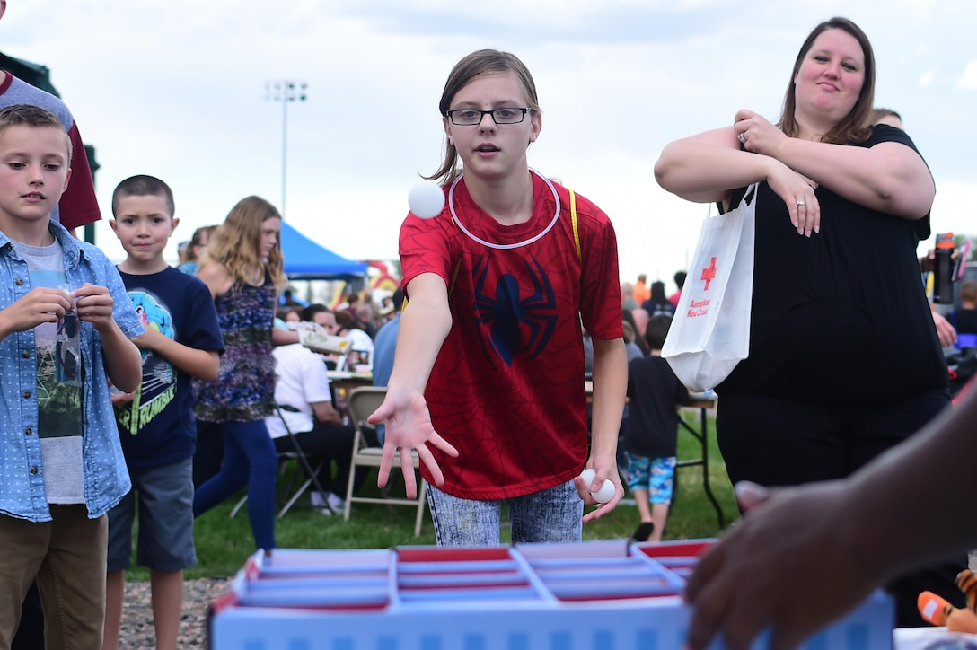 Anna, a Buckley Air Force Base child, tosses a ping pong ball at a target during FunFest Aug. 26, 2016, on Buckley AFB, Colo. FunFest provides attraction for all ages and is an annual fair for the base community. (U.S. Air Force photo by Senior Airman Luke W. Nowakowski/Released)