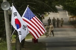 South Korean and American flags fly next to each other in Yongin, South Korea, Aug. 23, 2016. Army photo by Staff Sgt. Ken Scar