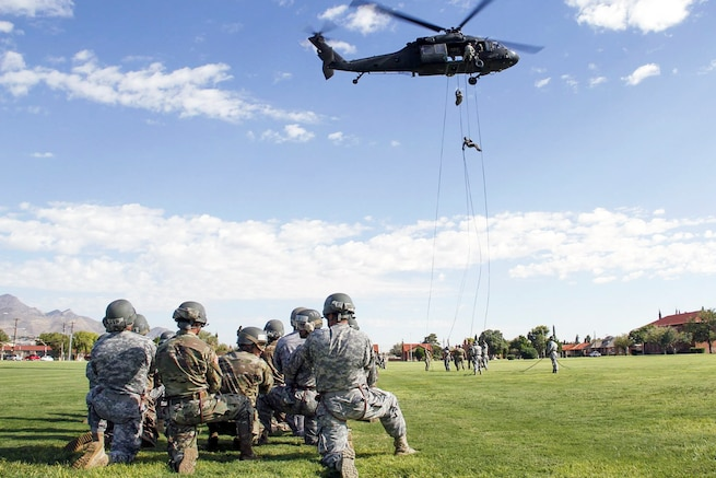 Soldiers rappel from a UH-60 Black Hawk helicopter during air assault training at Fort Bliss, Texas, Aug. 23, 2016. Army photo by Abigail Meyer