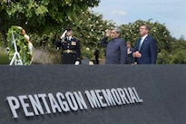 Defense Secretary Ash Carter, right, and Indian Defense Minister Manohar Parrikar render honors after laying a wreath at the 9/11 Pentagon Memorial, Aug. 29, 2016. The two leaders also held a press conference after meeting to discuss matters of mutual interest. DoD photo by Navy Petty Officer 1st Class Tim D. Godbee