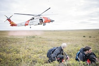 An MH-60 Jayhawk helicopter from U.S. Coast Guard Air Station Kodiak lands near simulated casualties for patient extraction during exercise Arctic Chinook, near Kotzebue, Alaska, August 24. Arctic Chinook is a joint U.S. Coast Guard and U.S. Northern Command sponsored exercise which focuses on multinational search and rescue readiness to respond to a mass rescue operation requirement in the Arctic. (U.S. Air National Guard photo by Staff Sgt, Edward Eagerton/released)