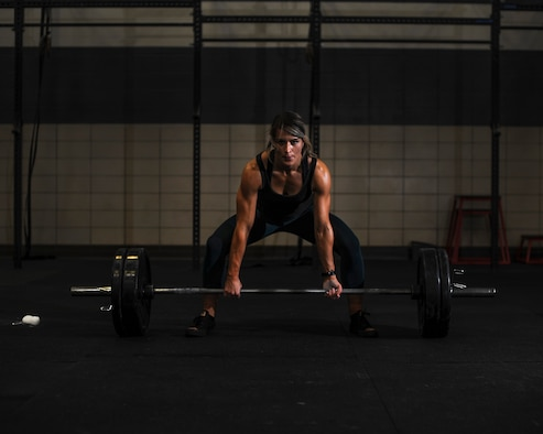 U.S. Air Force Staff Sgt. Macy Benjamin, 355th Contracting Squadron contract administrator, prepares to perform a dead lift at the Haeffner Fitness and Sports Center at Davis-Monthan Air Force Base, Ariz., Aug. 25, 2016. Benjamin uses weightlifting as a personal escape from everyday stressors. (U.S. Air Force photo by Airman 1st Class Ashley N. Steffen)