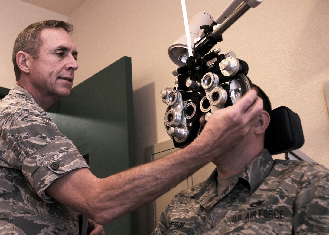 Lt. Col. Robert Kautz, 120th Medical Group optometrist, performs an eye exam of Tech. Sgt. Keith Gottlob, aircraft electrical and environmental technician, at the 120th Airlift Wing, Great Falls, Mont., Aug. 17, 2016. The 120th Medical Group received the highest score during an inspection by the National Guard Bureau Joint Surgeon's Office. (U.S. Air National Guard photo by Staff Sgt. Lindsey Soulsby/Released)