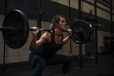 U.S. Air Force Staff Sgt. Macy Benjamin, 355th Contracting Squadron contract administrator, performs a squat exercise at the Haeffner Fitness and Sports Center at Davis-Monthan Air Force Base, Ariz., Aug. 25, 2016. Benjamin has used fitness to boost her self-esteem and finds happiness within her workouts. (U.S. Air Force photo by Airman 1st Class Ashley N. Steffen)