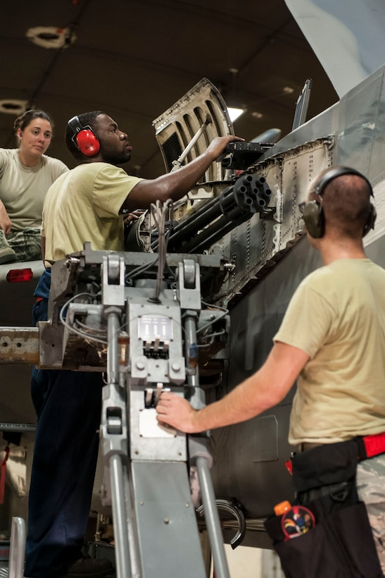 Staff Sgt. James Smith, 67th Aircraft Maintenance Unit weapons load crew chief, checks computer data on an F-15 Eagle Aug. 24, 2016, at Kadena Air Base, Japan. Smith led his load crew in an M-61A1 cannon swap project for the aircraft. (U.S. Air Force photo by Senior Airman Peter Reft)