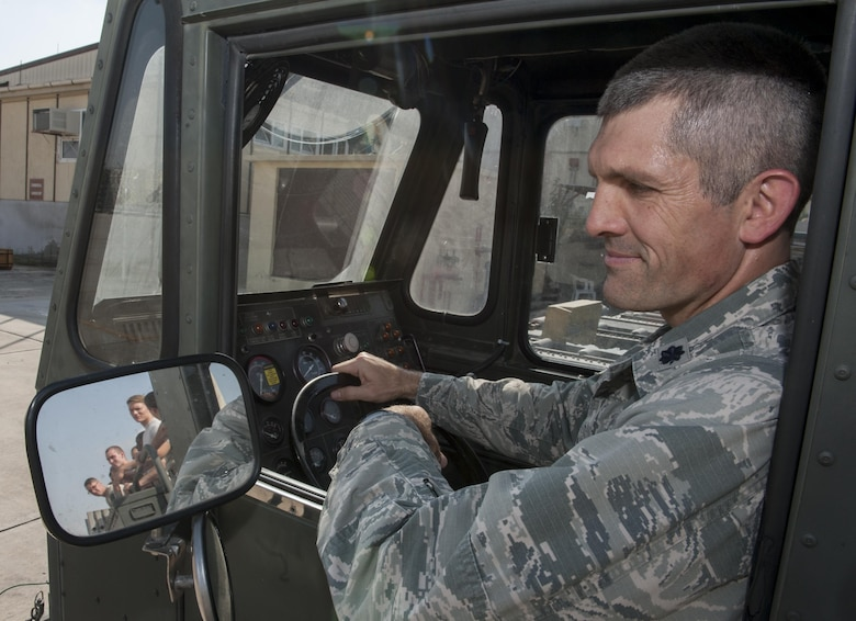 U.S. Air Force Lt. Col. Nathan Mansfield, 728th Air Mobility Squadron (AMS) commander, sits in a K-Loader watching the Airmen from his squadron in the side mirror Aug. 25, 2016, at Incirlik Air Base, Turkey. Mansfield took command of the 728th AMS June 9, 2016. (U.S. Air Force photo by Staff Sgt. Jack Sanders)