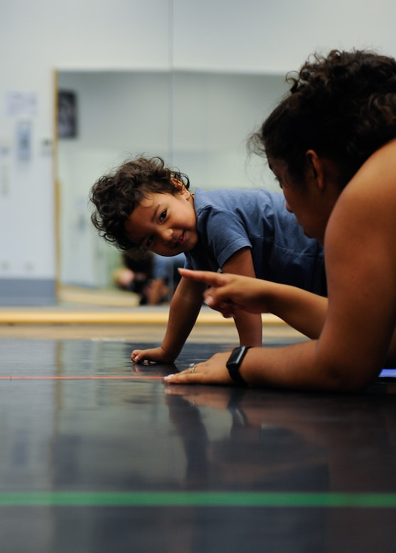 Roy Barrios watches his mother, Kadyzshea Barrios, during a Mommy and Me Yoga class Aug. 29, 2016, at Ramstein Air Base, Germany. The Mommy and Me Yoga course is offered every Monday, starting Aug. 29. (U.S. Air Force photo/ Airman 1st Class Savannah L. Waters)