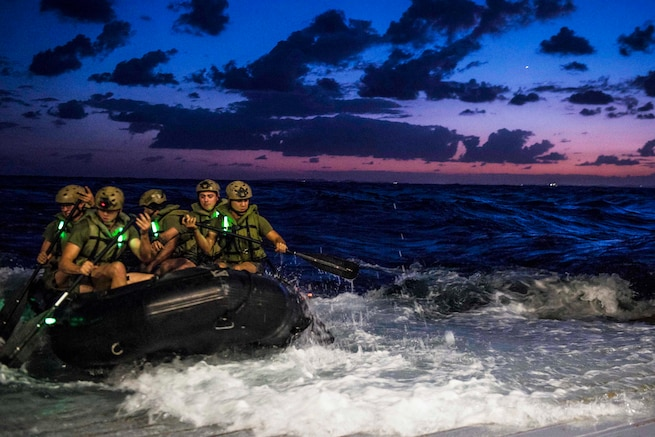 Marines depart the well deck of the USS Green Bay in a combat rubber raiding craft in the Pacific Ocean, Aug. 29, 2016. The Green Bay is supporting security and stability in the Indo-Asia-Pacific region. The Marines are assigned to the 31st Marine Expeditionary Unit. Navy photo by Petty Officer 3rd Class Patrick Dionne