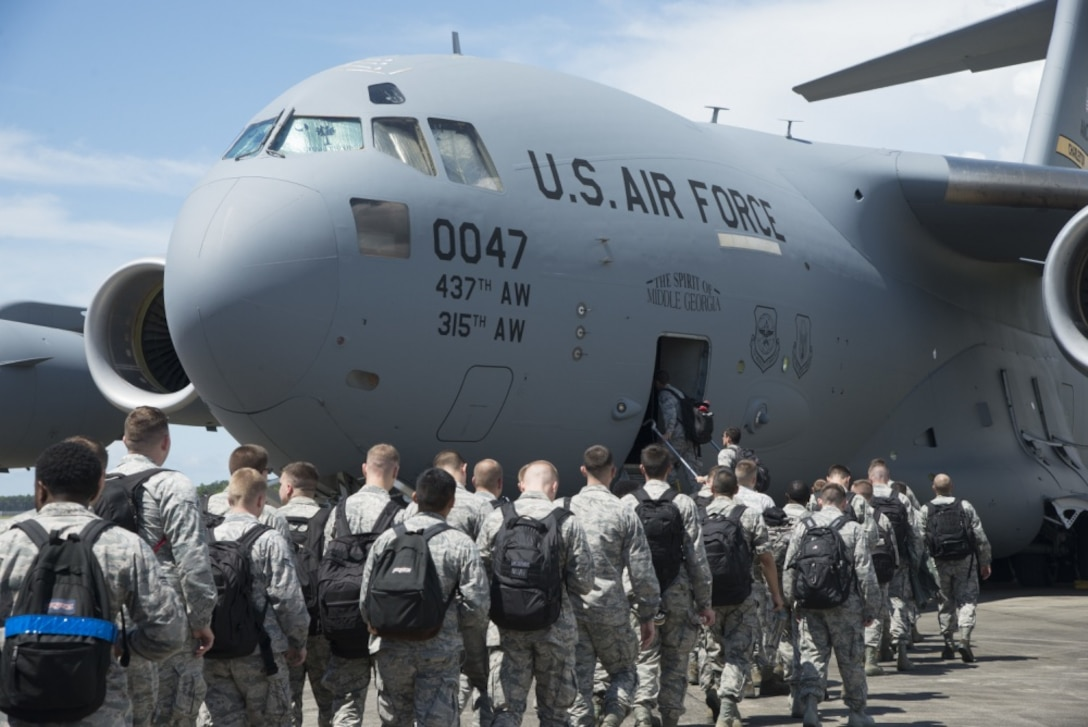 33rd Fighter Wing Airmen board a C-17 Globemaster III Aug. 19, 2016, at Eglin Air Force Base, Fla. The C-17 transported 33rd FW members to Volk Field, Wis. to take part in Northern Lightning, a tactical-level, joint training exercise that emphasizes fifth and fourth generation assets engaged in a contested, degraded environment. (U.S. Air Force photo by Senior Airman Stormy Archer)