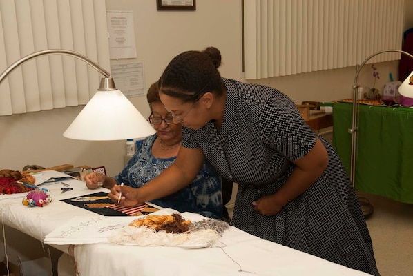 Actress Alex Ford, who portrayed Civil Rights heroine Rosa Parks during a Women's Equality Day event Aug. 24 at Defense Logistics Agency Troop Support, signs a presidential flag while visiting the Flag Room. Ford detailed Parks' life of activism and experiences that shaped her involvement in the Civil Rights Movement, including her difficulties gaining the right to vote.