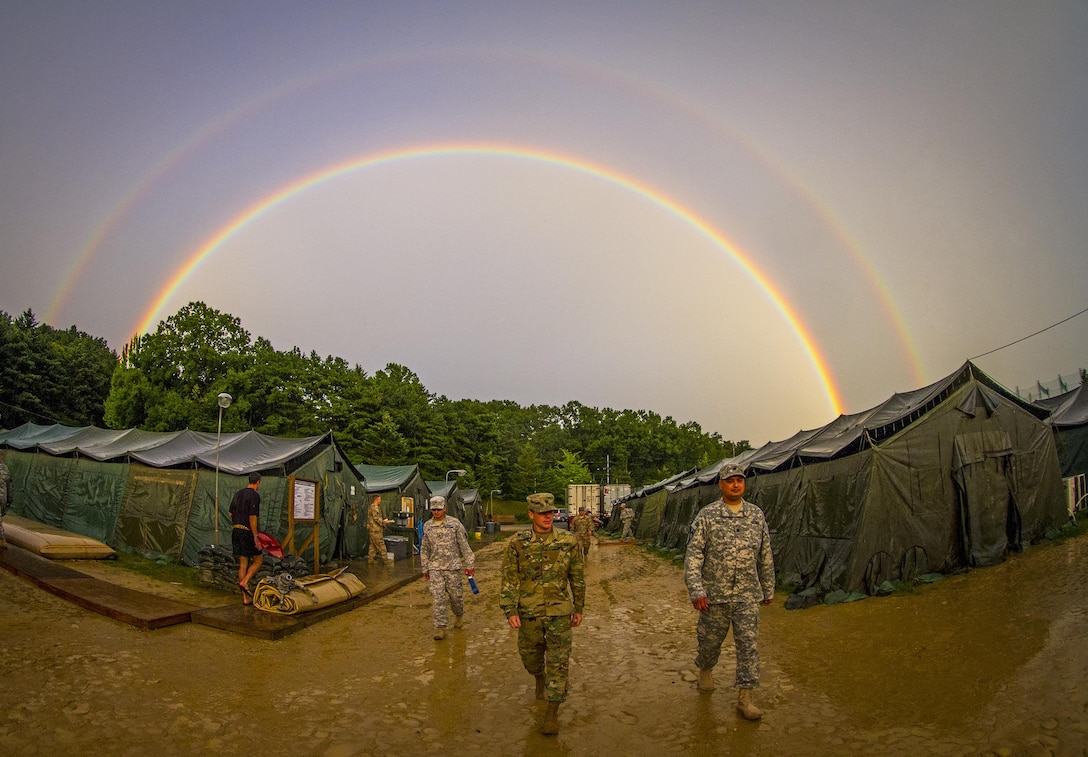 The rain subsides long enough for a rainbow to arch over a tent city constructed by I Corps and Korean Army soldiers for U.S. and Canadian army personnel conducting a two-week training mission at Yongin, South Korea, Aug. 27, 2016.  (U.S. Army photo by Staff Sgt. Ken Scar)