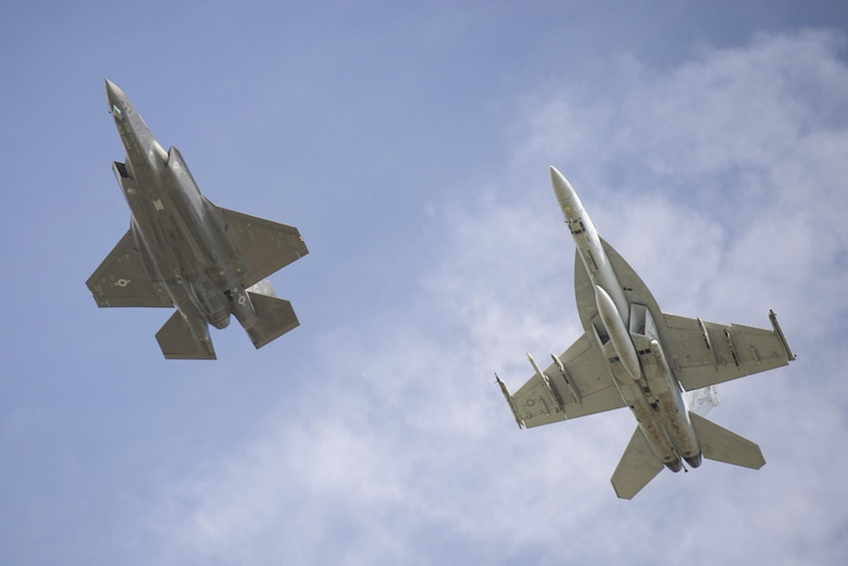 An F-35A and an FA-18 Super Hornet fly in formation over Volk Field Wis. during Northern Lightning, Aug. 23, 2016. Northern Lightning is a tactical-level, joint training exercise that emphasizes fifth and fourth generation assets engaged in a contested, degraded environment. (U.S. Air Force photo by Senior Airman Stormy Archer)
