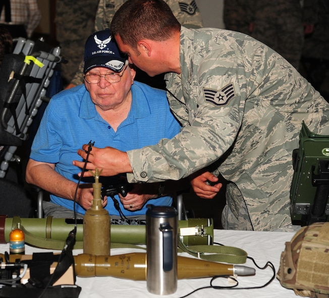 U.S. Air Force Staff Sgt. Kyle Bemis, a vehicle maintenance manager from the 509th Logistics Readiness Squadron, describes some of the items on display to a veteran at Whiteman Air Force Base, Mo., Aug. 26, 2016. Veterans from the Missouri Veterans' Home visited Whiteman and learned about various squadrons on base and each unit's mission. (U.S. Air Force photo by Senior Airman Joel Pfiester)