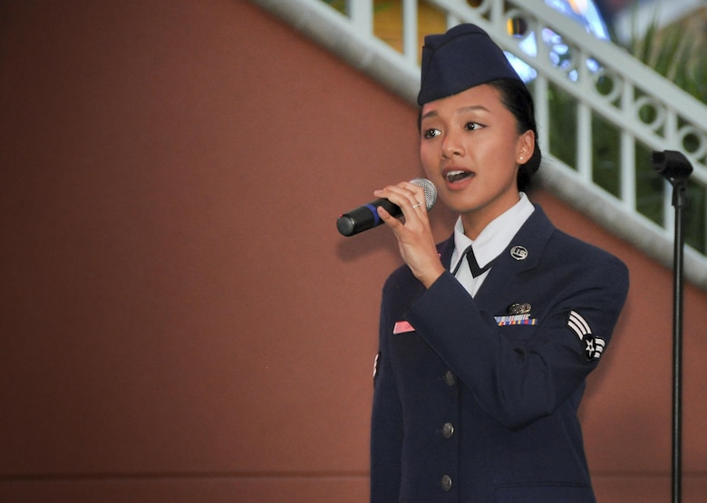 Senior Airman Christine David, 96th Aircraft Maintenance Squadron and former Tops in Blue singer, belts out the National Anthem during the Harborwalk Village's Red, White and Blue Hero celebration Aug. 25 in Destin, Fla.  (U.S. Air Force photo/Lt. Col. James Wilson)