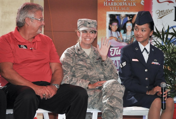 Col. Regina Sabric, the 919th Special Operations Group commander, was honored at the Harborwalk Village's Red, White and Blue Hero celebration Aug. 25 in Destin, Fla.  She was one of a few honorees highlighted during the weekly summer event.  (U.S. Air Force photo/Lt. Col. James Wilson)