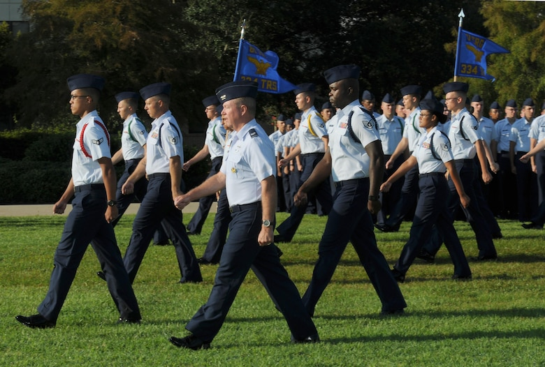 Col. Scott Solomon, 81st Training Group commander, leads Airmen to their formation during the 2nd Air Force change of command ceremony at the Levitow Training Support Facility Aug. 26, 2016, on Keesler Air Force Base, Miss. Maj. Gen. Bob LaBrutta assumed command from Maj. Gen. Mark Brown who is heading to Joint Base San Antonio-Randolph, Texas, where he will become the Air Education and Training Command vice commander. (U.S. Air Force photo by Kemberly Groue/Released)