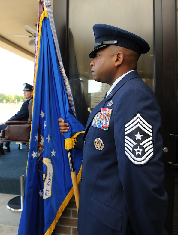 Chief Master Sgt. Farrell Thomas, 2nd Air Force command chief, holds the guidon during the 2nd AF change of command ceremony at the Levitow Training Support Facility Aug. 26, 2016, on Keesler Air Force Base, Miss. Maj. Gen. Bob LaBrutta, incoming 2nd AF commander, was previously the 502nd Air Base Wing and Joint Base San Antonio, Texas, commander. He replaces Maj. Gen. Mark Brown, who is heading to Joint Base San Antonio-Randolph, Texas, where he will become the Air Education and Training Command vice commander. (U.S. Air Force photo by Kemberly Groue/Released)