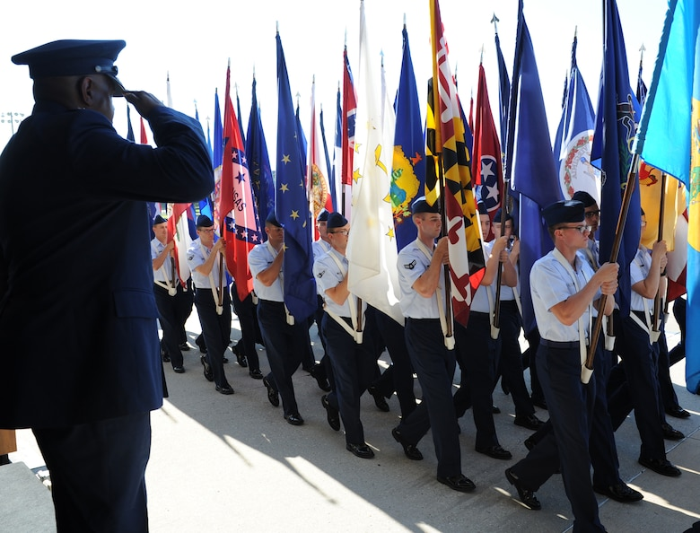 Maj. Gen. Mark Brown, outgoing 2nd Air Force commander, renders a salute as troops march during the pass and review following the 2nd AF change of command ceremony at the Levitow Training Support Facility Aug. 26, 2016, on Keesler Air Force Base, Miss. Brown, who will become the Air Education and Training Command vice commander at Joint Base San Antonio-Randolph, Texas, is replaced by Maj. Gen. Bob LaBrutta, who was previously the 502nd Air Base Wing and Joint Base San Antonio, Texas, commander. (U.S. Air Force photo by Kemberly Groue/Released)
