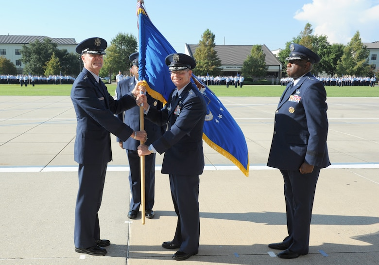 Lt. Gen. Darryl Roberson, commander, Air Education and Training Command, passes the 2nd Air Force flag to Maj. Gen. Bob LaBrutta, incoming 2nd AF commander, during the 2nd AF change of command ceremony at the Levitow Training Support Facility Aug. 26, 2016, on Keesler Air Force Base, Miss. LaBrutta was previously the 502nd Air Base Wing and Joint Base San Antonio, Texas, commander and assumed command from  Maj. Gen. Mark Brown, who is heading to Joint Base San Antonio-Randolph, Texas, where he will become the AETC vice commander. (U.S. Air Force photo by Kemberly Groue/Released)