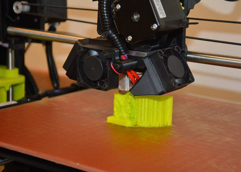 Users of the Maker Hub's 3-D printer can make their own creations using computer-aided design or can explore the many shared designs available through the vast online Maker community.  (U.S. Air Force photo/Lori Hughes)
