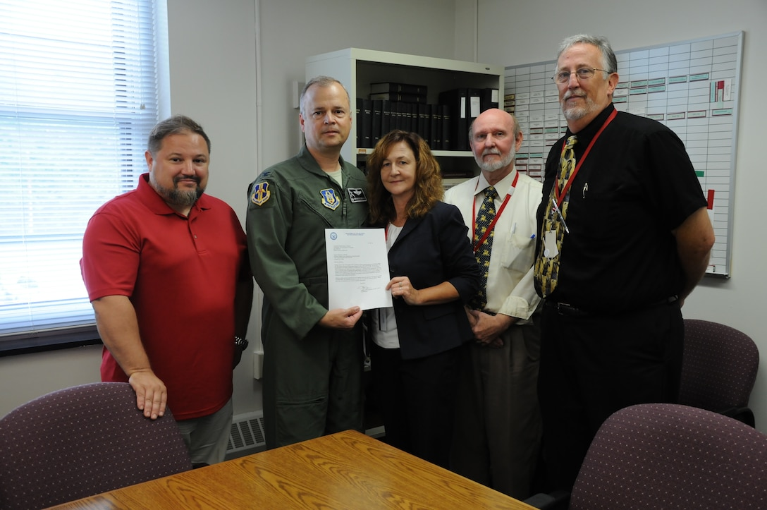 Col. Brian Bowman, commander, 914th Airlift Wing and Dan Norton (left), director of Psychological Health, 914 AW, pose for a photo with Laura Kellemen, director, Niagara County Department of Mental Health, Michael White (right), deputy director and Jim Swift (far right), supervising social worker during a visit to their office on Aug. 25, 2016. Bowman and Dan Norton, Director of Psychological Health, 914 AW (far left) were there to present a letter of recognition. (U.S. Air Force photo by Tech. Sgt. Matthew Burke)
