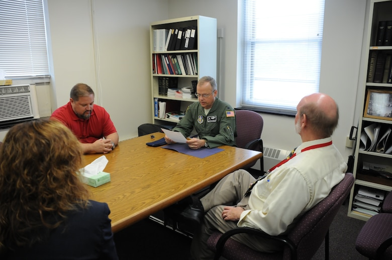 Col. Brian Bowman, commander, 914th Airlift Wing, reads from a letter of recognition from Lt. Gen. James Jackson to members of the Niagara County Department of Mental Health on Aug. 25, 2016. The letter was thanked the organization for their work with Dan Norton (left), Director of Psychological Health, 914 AW. (U.S. Air Force photo by Tech. Sgt. Matthew Burke)