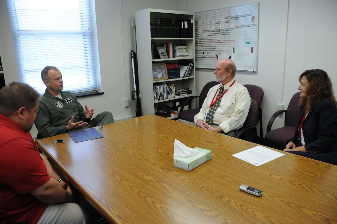 Col. Brian Bowman, commander, 914th Airlift Wing talks with Michael White, deputy director and Laura Kelemen, (far right) director, Niagara County Department of Mental Health during a visit to their office on Aug. 25, 2016. Bowman and Dan Norton, Director of Psychological Health, 914 AW (far left) were there to present a letter of recognition. (U.S. Air Force photo by Tech. Sgt. Matthew Burke)